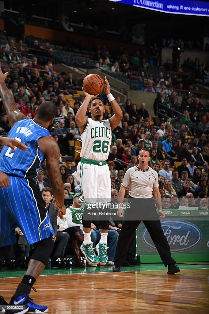 Phil Pressey of the Boston Celtics shoots the ball against the Orlando Magic during the game on December 17 2014 at the TD Garden in Boston...