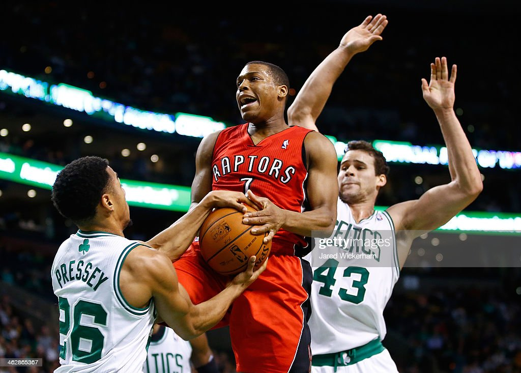 Phil Pressey of the Boston Celtics steals the ball from the hands of Kyle Lowry of the Toronto Raptors in the second half during the game at TD...