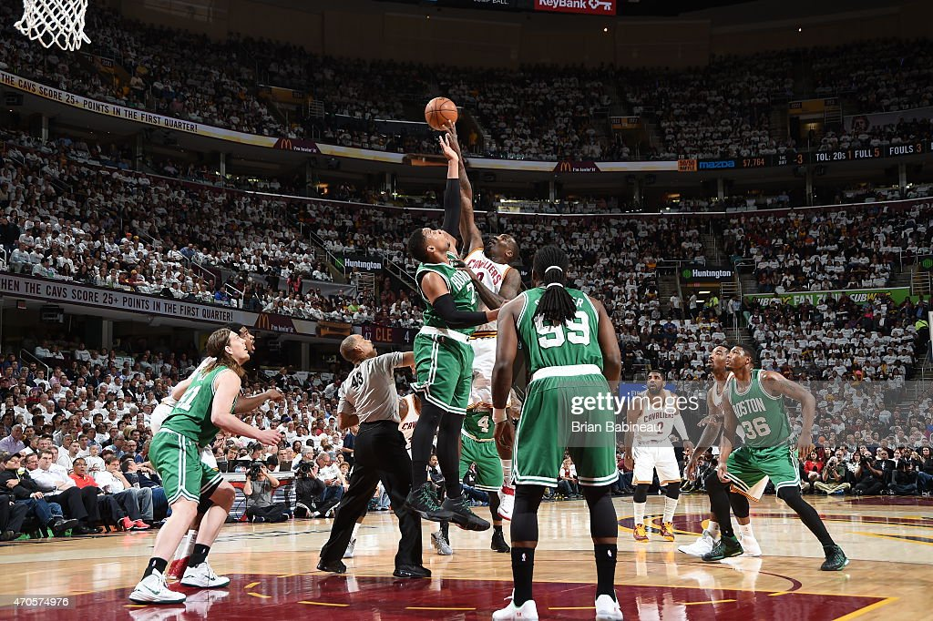 Phil Pressey of the Boston Celtics tips the ball against Kendrick Perkins of the Cleveland Cavaliers during Game Two of the Eastern Conference...