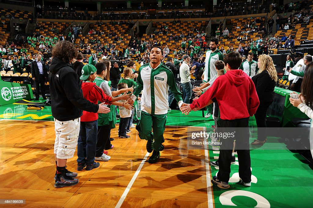 Phil Pressey of the Boston Celtics warms up before the game against the Utah Jazz on November 6 2013 at the TD Garden in Boston Massachusetts NOTE TO...