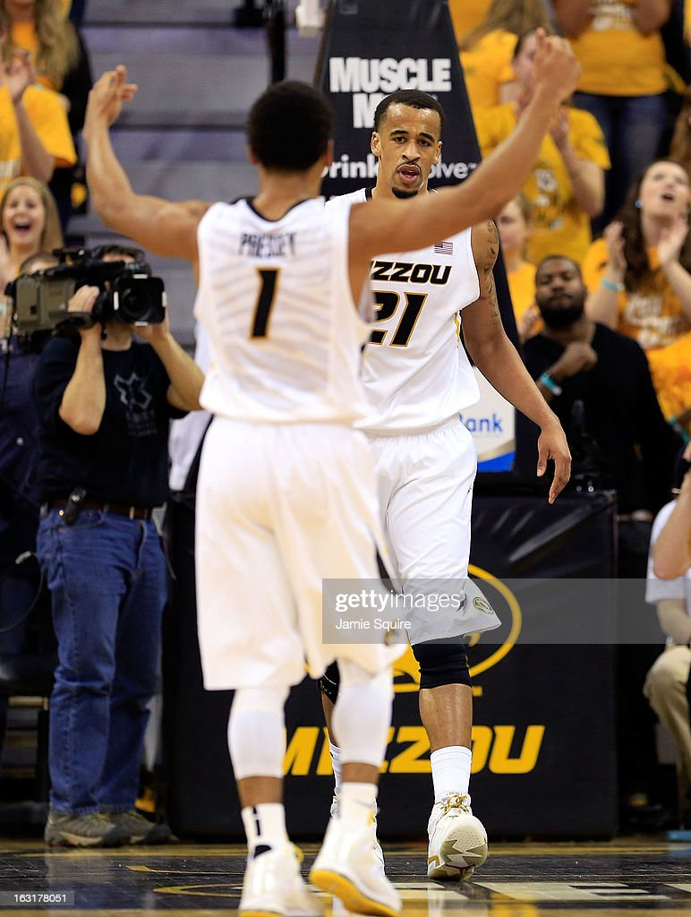 Phil Pressey #1 of the Missouri Tigers congratulates Laurence Bowers #21 after Bowers scored during the against the Arkansas Razorbacks game at Mizzou Arena on March 5, 2013 in Columbia, Missouri.