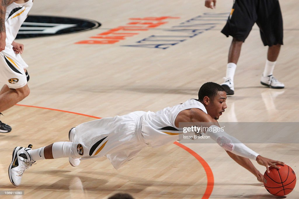 Phil Pressey #1 of the Missouri Tigers dives for a loose ball during the Battle 4 Atlantis tournament at Atlantis Resort November 24, 2012 in Nassau, Paradise Island, Bahamas. (Photo by Issac Baldizon/Getty Images)Phil Pressey