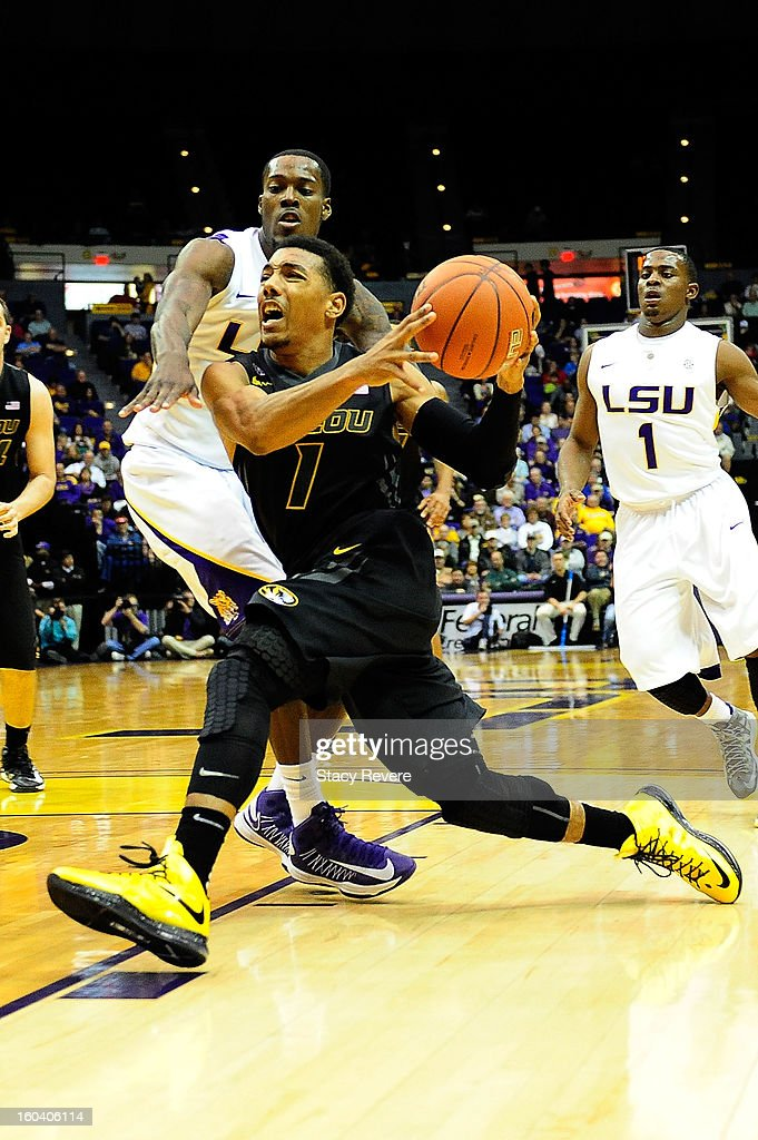 Phil Pressey #1 of the Missouri Tigers drives around Shavon Coleman #5 of the LSU Tigers during a game at the Pete Maravich Assembly Center on January 30, 2013 in Baton Rouge, Louisiana. LSU won the game 73-70.