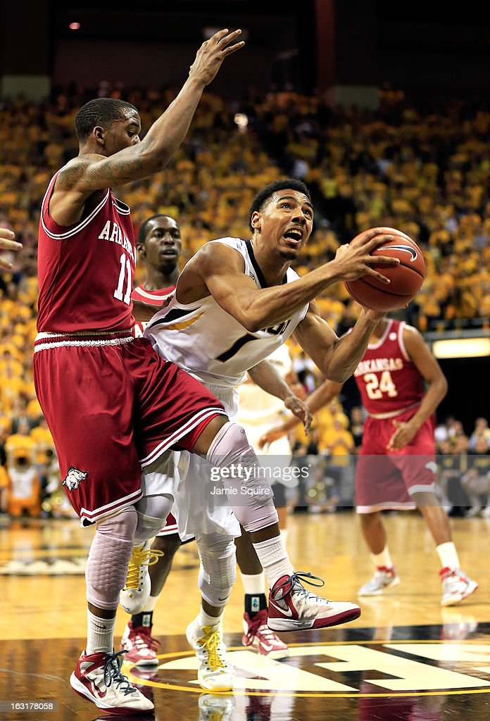 Phil Pressey #1 of the Missouri Tigers drives toward the basket as BJ Young #11 of the Arkansas Razorbacks defends during the game at Mizzou Arena on March 5, 2013 in Columbia, Missouri.