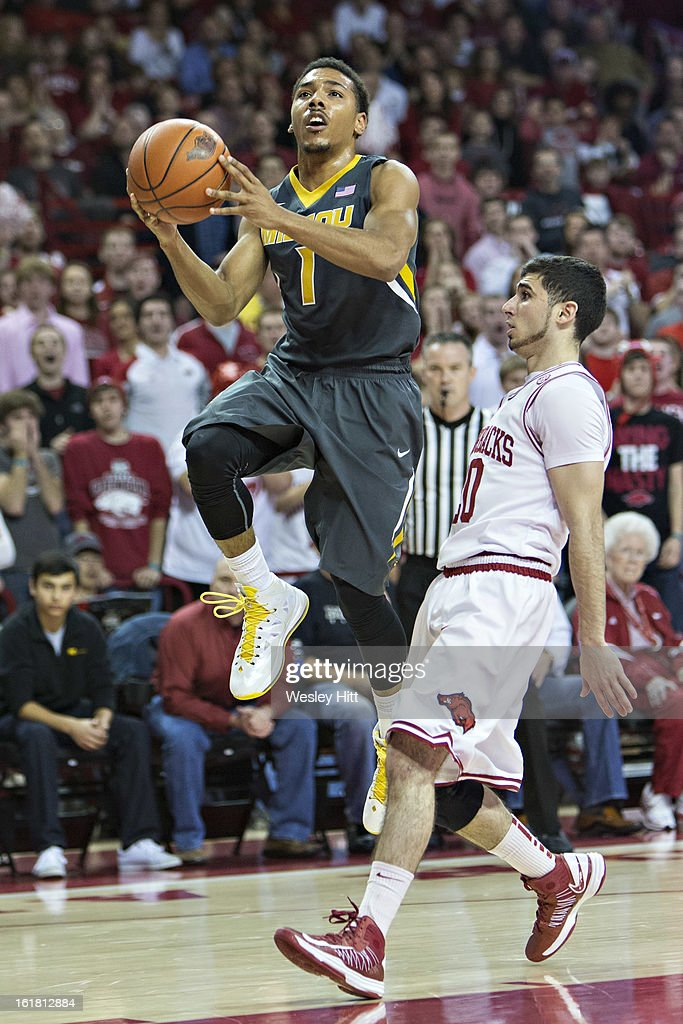 Phil Pressey #1 of the Missouri Tigers goes up for a shot past Kikko Haydar #20 of the Arkansas Razorbacks at Bud Walton Arena on February 16, 2013 in Fayetteville, Arkansas. The Razorbacks defeated the Tigers 73-71.