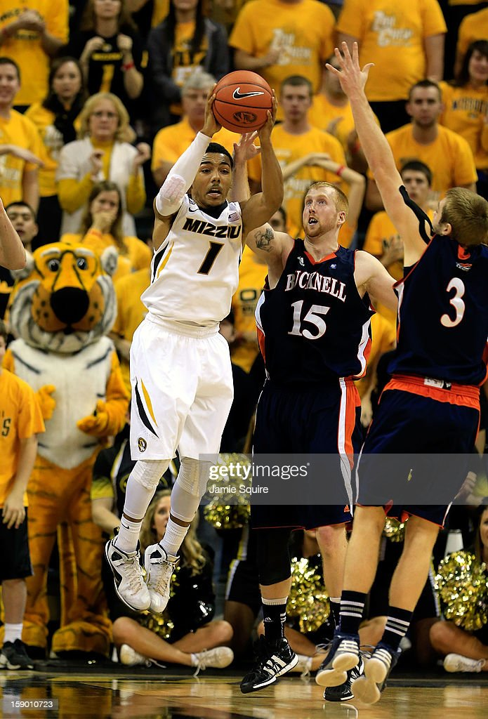 Phil Pressey #1 of the Missouri Tigers grabs an offensive rebound during the game against the Bucknell Bison at Mizzou Arena on January 5, 2013 in Columbia, Missouri.