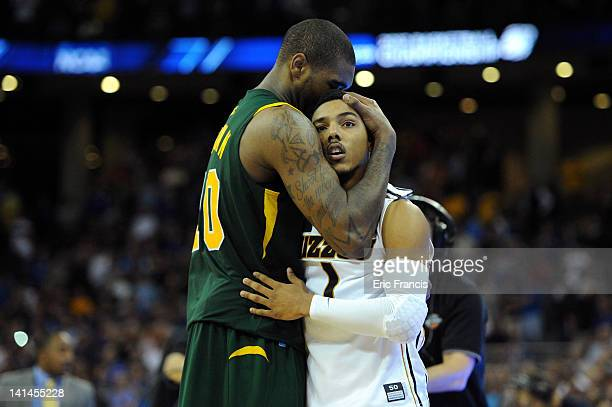 Phil Pressey of the Missouri Tigers is consoled by Kyle O'Quinn of the Norfolk State Spartans after Pressey missed a potential go ahead basket at the...