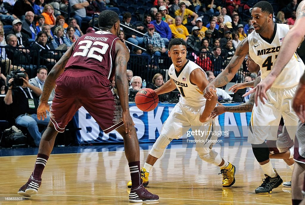 Phil Pressey #1 of the Missouri Tigers plays against the Texas A&M Aggies during the second round of the SEC Men's Basketball Tournament at the Bridgestone Arena on March 14, 2013 in Nashville, Tennessee.