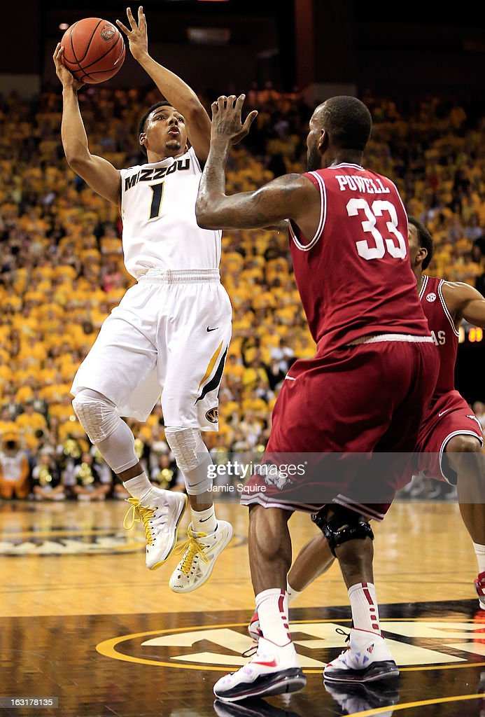 Phil Pressey #1 of the Missouri Tigers shoots over Marshawn Powell #33 of the Arkansas Razorbacks during the game at Mizzou Arena on March 5, 2013 in Columbia, Missouri.