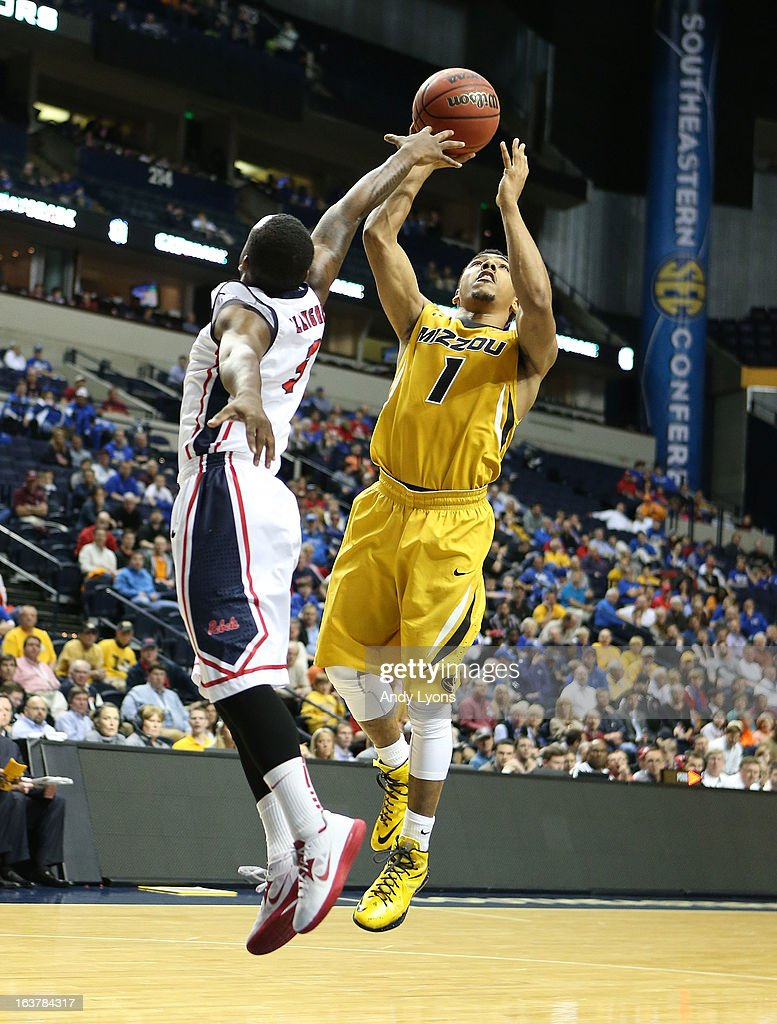 Phil Pressey #1 of the Missouri Tigers shoots the ball against the Ole Miss Rebels during the quarterfinals of the SEC Baketball Tournament at Bridgestone Arena on March 15, 2013 in Nashville, Tennessee.