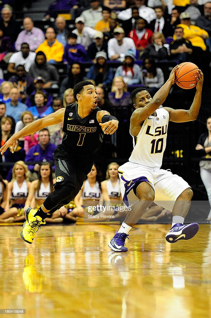 Phil Pressey #1 of the Missouri Tigers tries to steal the ball from Andre Stringer #10 of the LSU Tigers during a game at the Pete Maravich Assembly Center on January 30, 2013 in Baton Rouge, Louisiana. LSU won the game 73-70.