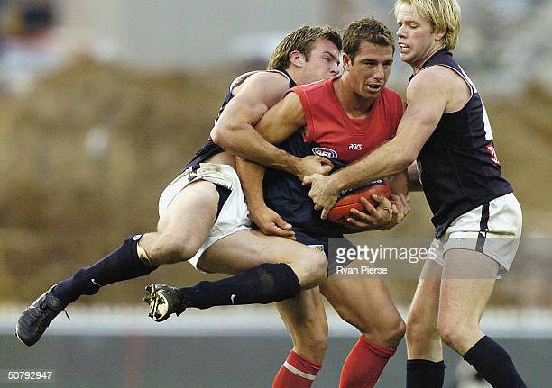 Phil Read number 36 for the Demons is tackled by Ian Prendergast number 28 for the Blues during the round six AFL match between The Melbourne Demons...