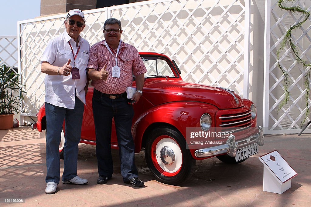Phil Read (L) poses with Adil Darukhanawala (R) with his 1949 500c Fiat during Cartier 'Travel With Style' Concours 2013 Opening at Taj Lands End on February 9, 2013 in Mumbai, India.
