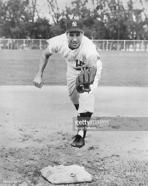 Phil Rizzuto of the New York Yankees poses for an action portrait circa 1951