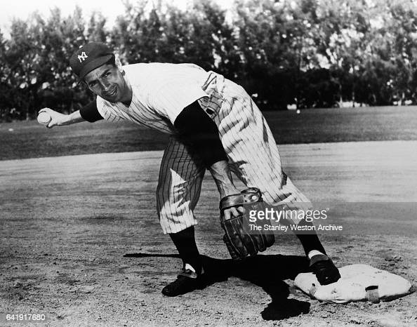 Phil Rizzuto shortstop of the New York Yankees throwing the ball circa 1945
