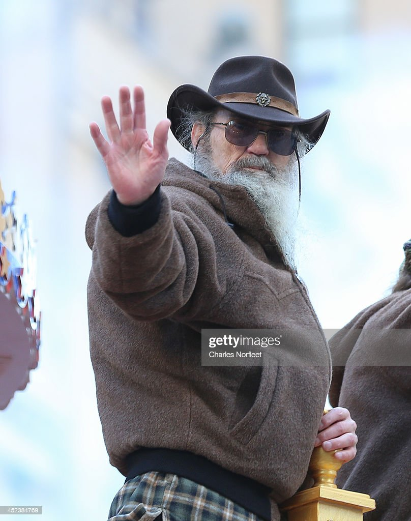 Phil Robertson of A&E television's 'Duck Dynasty' waves to the crowd during the 87th Annual Macy's Thanksgiving Day Parade on November 28, 2013 in New York City.
