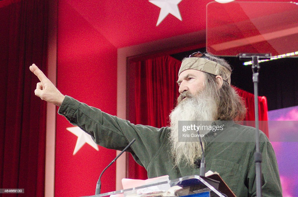 <a gi-track='captionPersonalityLinkClicked' href=/galleries/search?phrase=Phil+Robertson&family=editorial&specificpeople=4043277 ng-click='$event.stopPropagation()'>Phil Robertson</a> of A&E's Duck Dynasty addresses the 42nd annual Conservative Political Action Conference (CPAC) at the Gaylord National Resort Hotel and Convention Center on February 27, 2015 in National Harbor, Maryland. Conservative activists attended the annual political conference to discuss their agenda.
