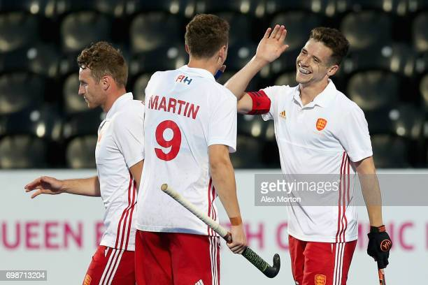 Phil Roper of England celebrates scoring his sides fifth goal with Harry Martin of England during the Pool A match between England and South Korea on...
