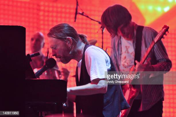 Phil Selway Thom Yorke and Jonny Greenwood of Radiohead perform on stage at The Frank Erwin Center on March 7 2012 in Austin Texas