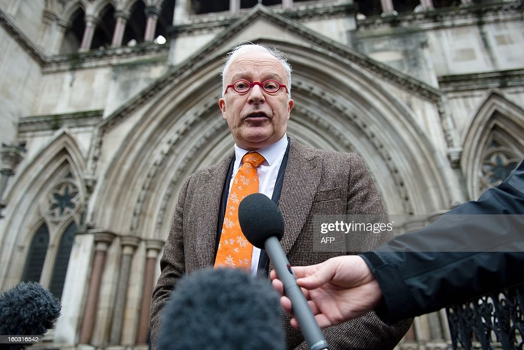 Phil Shiner of Public Interest Lawyers outlines his case against the Ministry of Defence to members of the media as he stands outside the High Court in central London on January 29, 2013. Shiner is representing a number of Iraqi civilians who claim to have been abused and tortured and seen family members killed by members of the British military. AFP PHOTO/Leon Neal