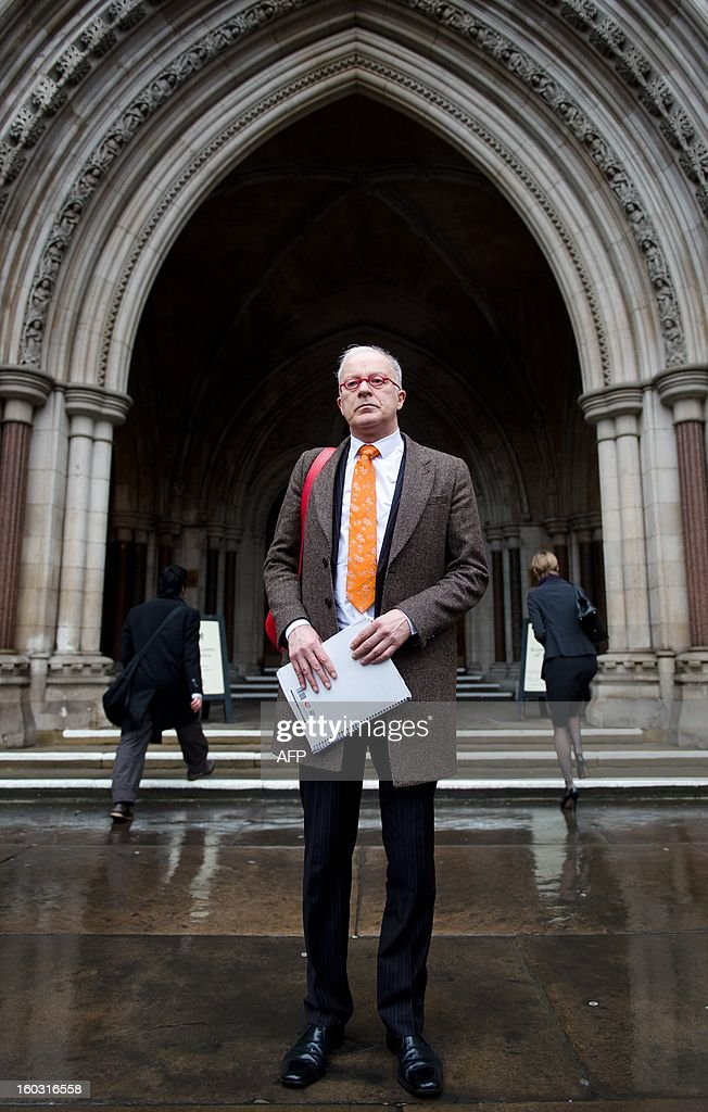 Phil Shiner of Public Interest Lawyers prepare to outline his case against the Ministry of Defence to members of the media as he stands outside the High Court in central London on January 29, 2013. Shiner is representing a number of Iraqi civilians who claim to have been abused and tortured and seen family members killed by members of the British military. AFP PHOTO/Leon Neal