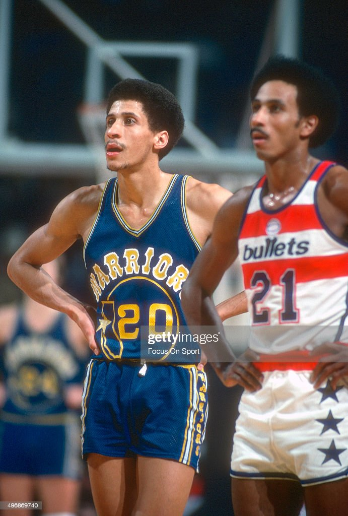 Phil smith 20 of the golden state warriors looks on with dave bing