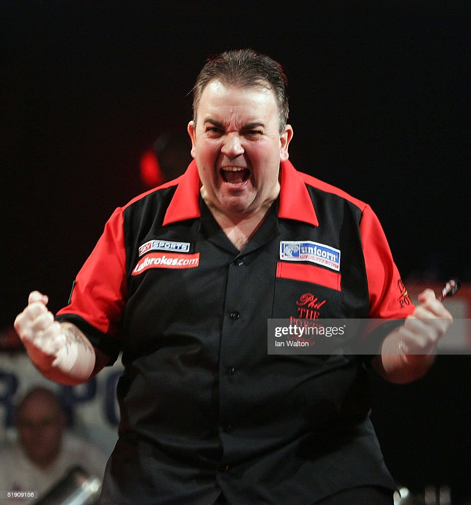 Phil Taylor celebrates winning his match against Bob Anderson during the 2005 Ladbrokes.com World Darts Championship at The Circus Tavern on January 2, 2005 in Purfleet, England.