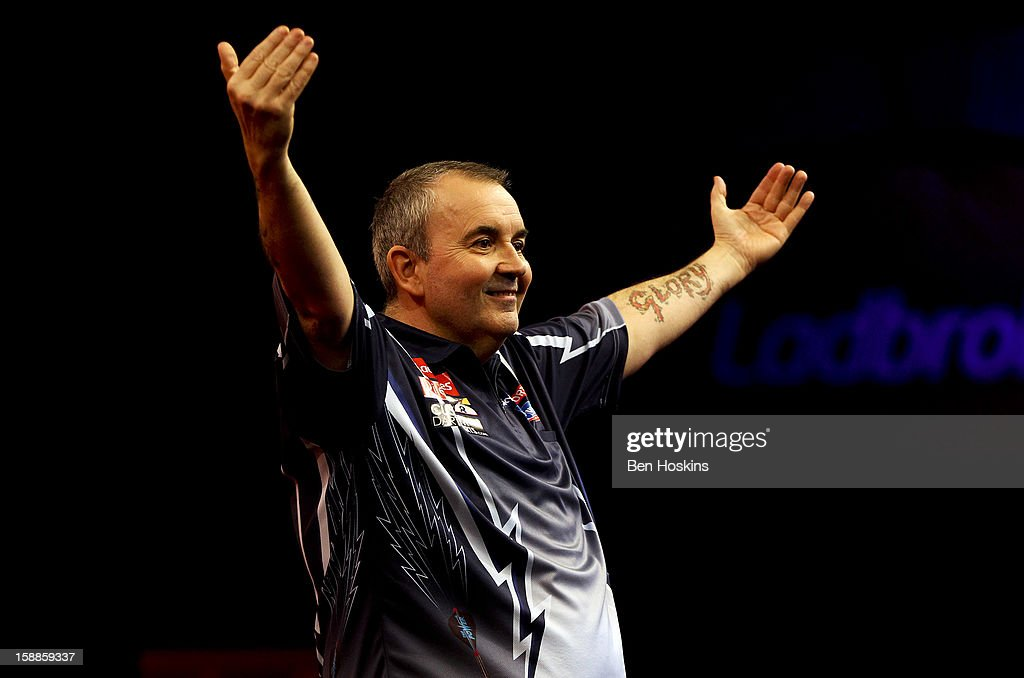 Phil Taylor celebrates winning the tenth set against Michael van Gerwen of the Netherlands during the final of the 2013 Ladbrokes.com World Darts Championship at the Alexandra Palace on January 1, 2013 in London, England.