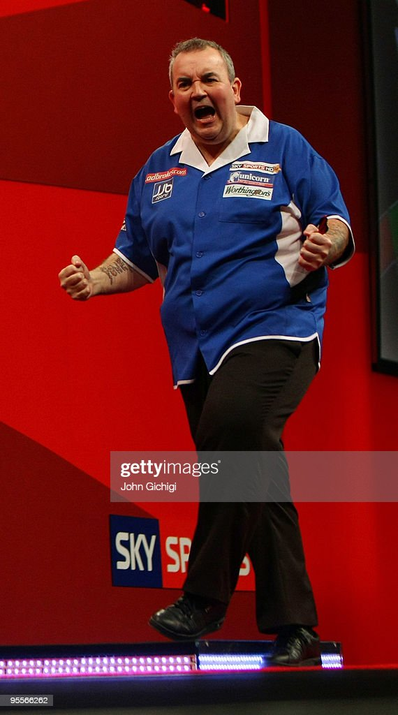 Phil Taylor of England celebrates a point in the game against Simon Whitlock of Australia during the Final of the Ladbrokes.com World Darts Championships at Alexandra Palace on January 3, 2010 in London, England.