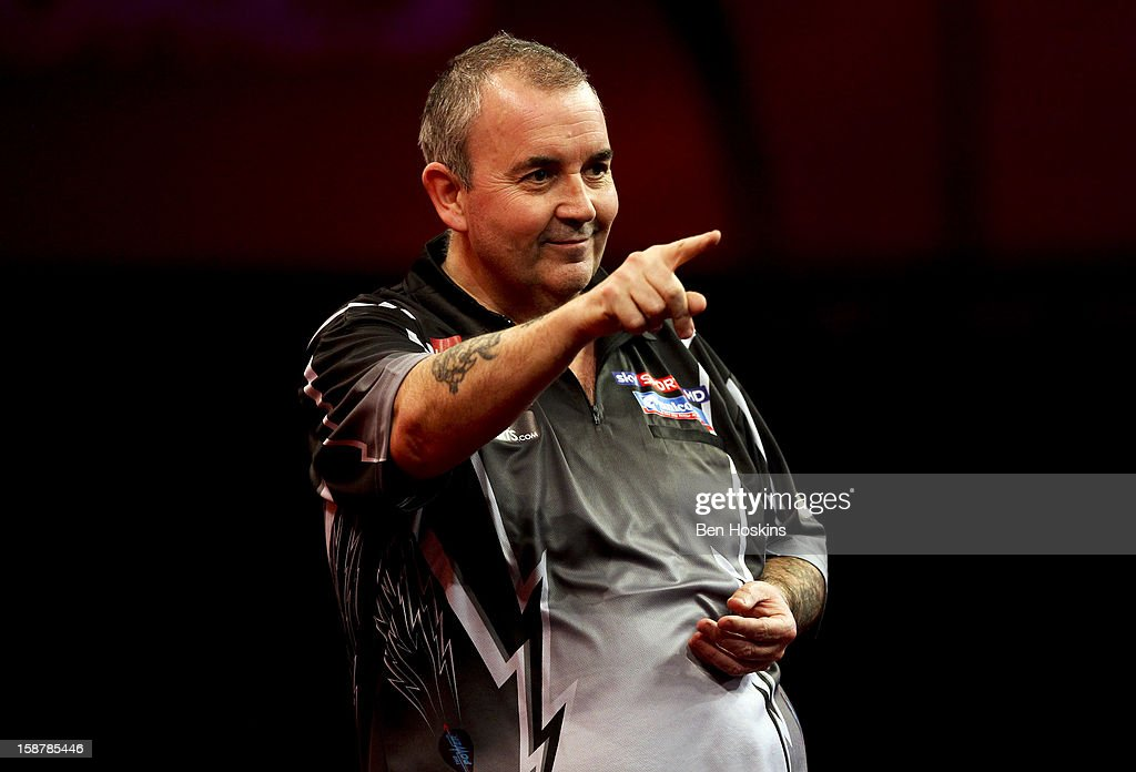 Phil Taylor of England celebrates during his quarter final match against Andy Hamilton of England on day twelve of the 2013 Ladbrokes.com World Darts Championship at the Alexandra Palace on December 28, 2012 in London, England.