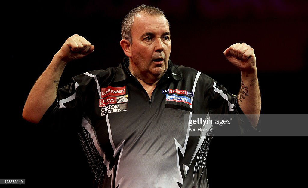 Phil Taylor of England celebrates during his quarter final match against Andy Hamilton of Englandon day twelve of the 2013 Ladbrokes.com World Darts Championship at the Alexandra Palace on December 28, 2012 in London, England.