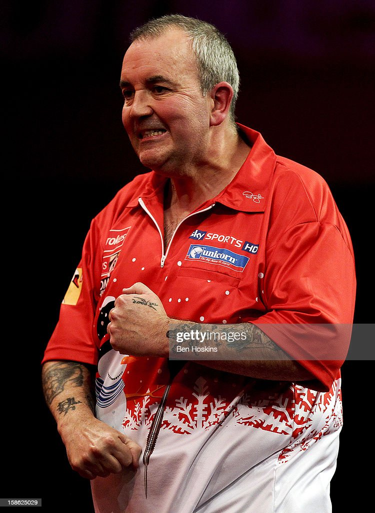 Phil Taylor of England celebrates during his second round match on day eight of the 2013 Ladbrokes.com World Darts Championship at the Alexandra Palace on December 21, 2012 in London, England.