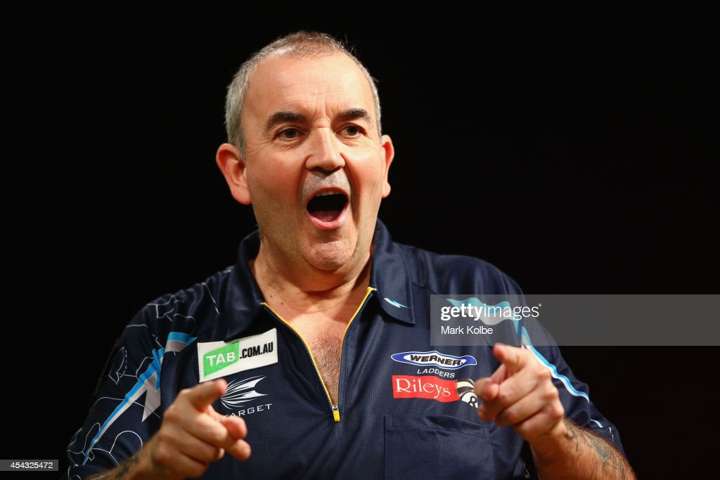 Phil Taylor of England celebrates victory in his quarter-final match against Dave Chisnall of England during the Sydney Darts Masters at Hordern Pavilion on August 29, 2014 in Sydney, Australia.