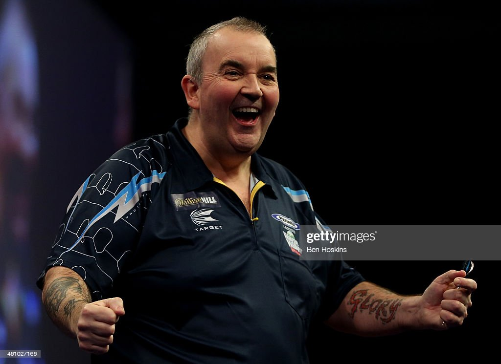 Phil Taylor of England celebrates winnin a set during the final of the 2015 William Hill PDC World Darts Championships at Alexandra Palace on January...
