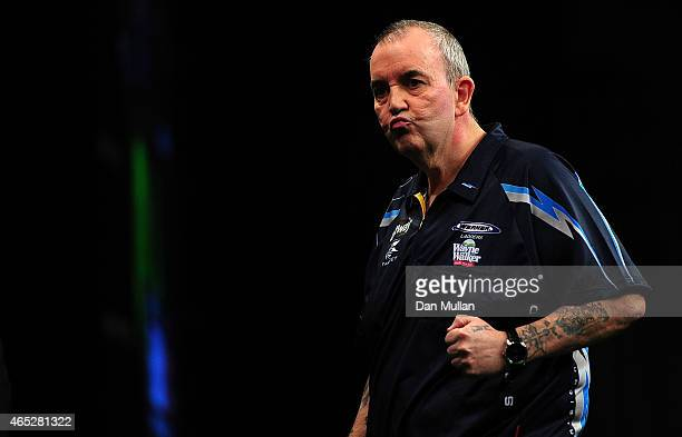 Phil Taylor of England celebrates winning a leg against James Wade of England during The Betway Premier League Darts at Westpoint Arena on March 5...