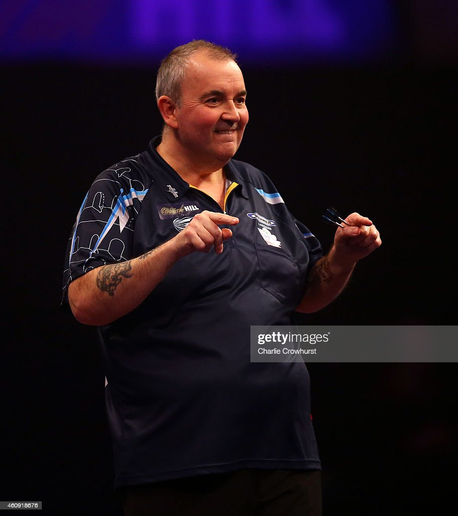 Phil Taylor of England celebrates winning a set during his third round match against Kim Huybrechts of Belgium during the William Hill PDC World Darts Championships on Day Ten at Alexandra Palace on December 30, 2014 in London, England.