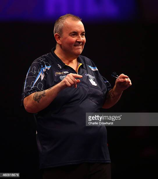 Phil Taylor of England celebrates winning a set during his third round match against Kim Huybrechts of Belgium during the William Hill PDC World...