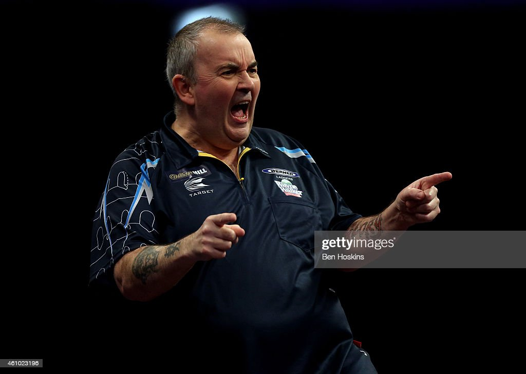 Phil Taylor of England celebrates winning a set during the final of the 2015 William Hill PDC World Darts Championships at Alexandra Palace on...