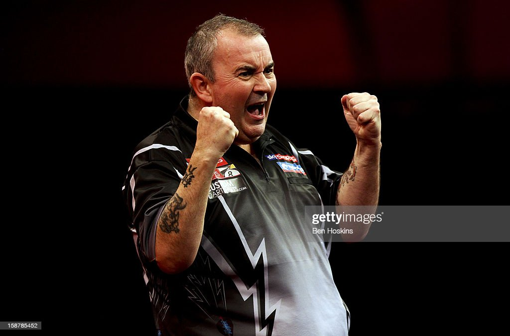 Phil Taylor of England celebrates winning his quarter final match against Andy Hamilton of England on day twelve of the 2013 Ladbrokes.com World Darts Championship at the Alexandra Palace on December 28, 2012 in London, England.