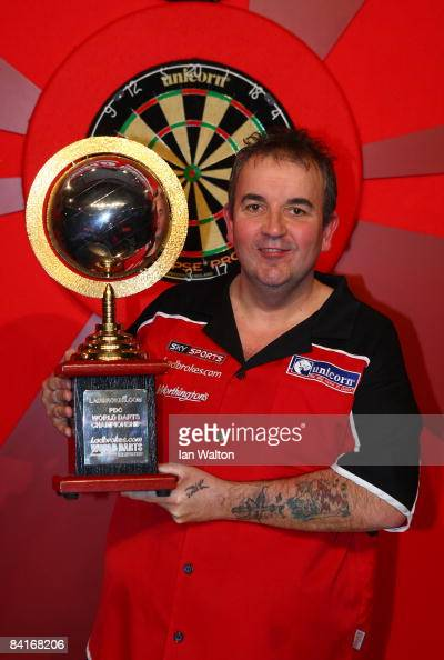 Phil Taylor of England celebrates winning the Final against Raymond Van Barneveld of the Netherlands during the 2009 Ladbrokescom PDC World Darts...