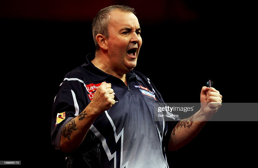 Phil Taylor of England celebrates winning the fourth set during the final of the 2013 Ladbrokes.com World Darts Championship against Michael van Gerwen of the Netherlands at the Alexandra Palace on January 1, 2013 in London, England.