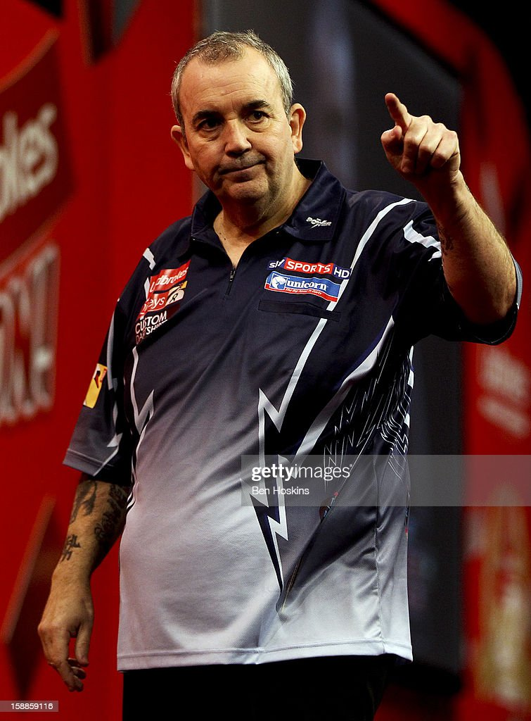 Phil Taylor of England celebrates winning the third set against Michael van Gerwen of the Netherlands during the final of the 2013 Ladbrokes.com World Darts Championship at the Alexandra Palace on January 1, 2013 in London, England.