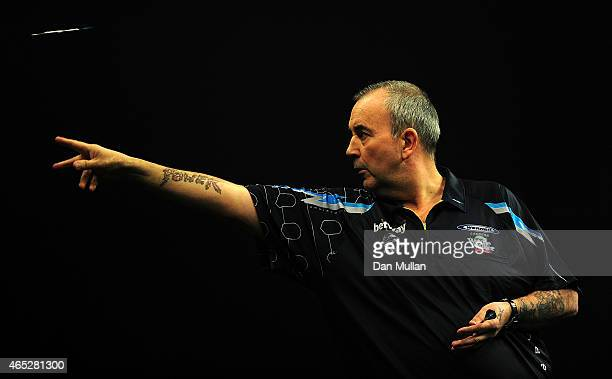 Phil Taylor of England competes against James Wade of England during The Betway Premier League Darts at Westpoint Arena on March 5 2015 in Exeter...