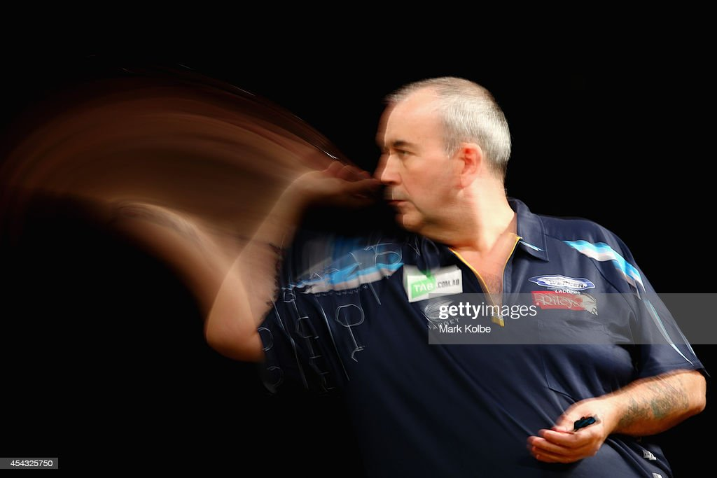 Phil Taylor of England competes in his quarter-final match against Dave Chisnall of England during the Sydney Darts Masters at Hordern Pavilion on August 29, 2014 in Sydney, Australia.