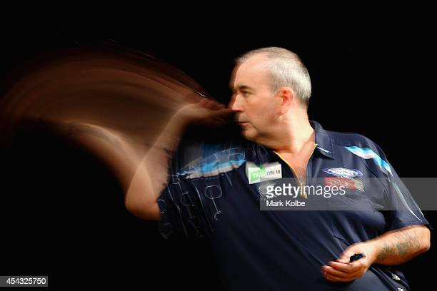 Phil Taylor of England competes in his quarterfinal match against Dave Chisnall of England during the Sydney Darts Masters at Hordern Pavilion on...