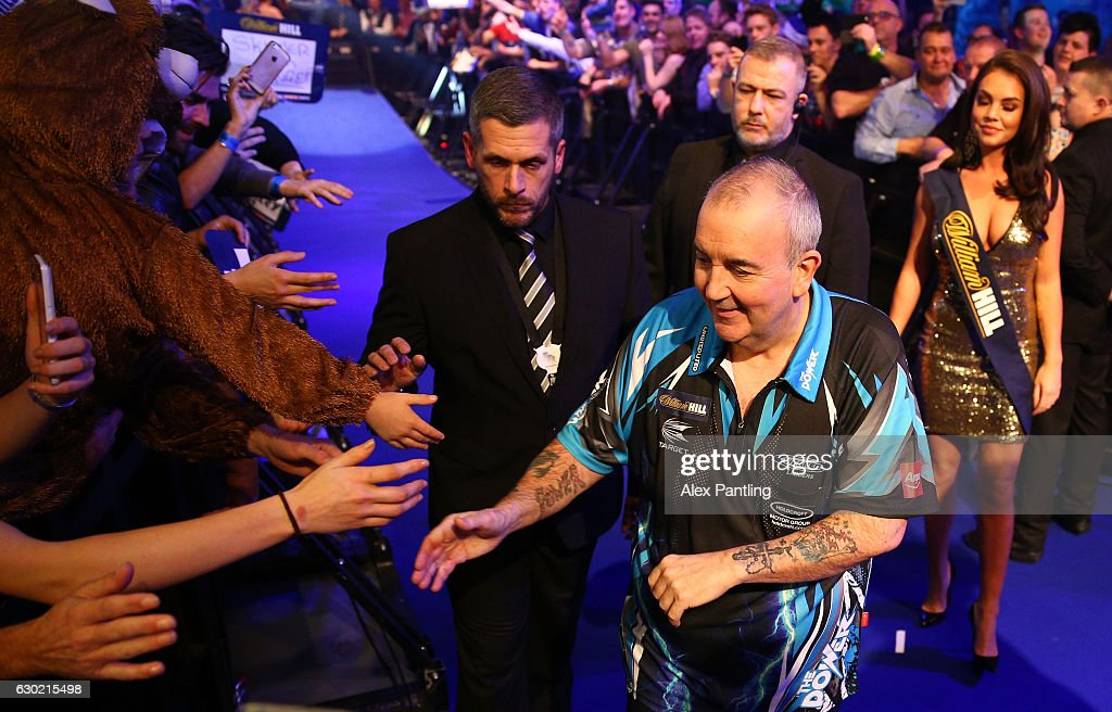 Phil Taylor of England greets supporters prior to his first round match against David Platt of England during Day Four of the 2017 William Hill PDC World Darts Championships at Alexandra Palace on December 18, 2016 in London, England.