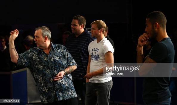 Phil Taylor of England in action during a dart show tournament at between team England and Hamburger SV at Imtech Arena on January 31 2013 in Hamburg...