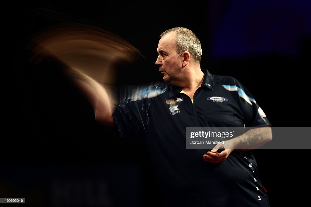 Phil Taylor of England in action during his first round match against Jyhan Artut of Germany on Day Two of the William Hill PDC World Darts Championships at Alexandra Palace on December 19, 2014 in London, England.