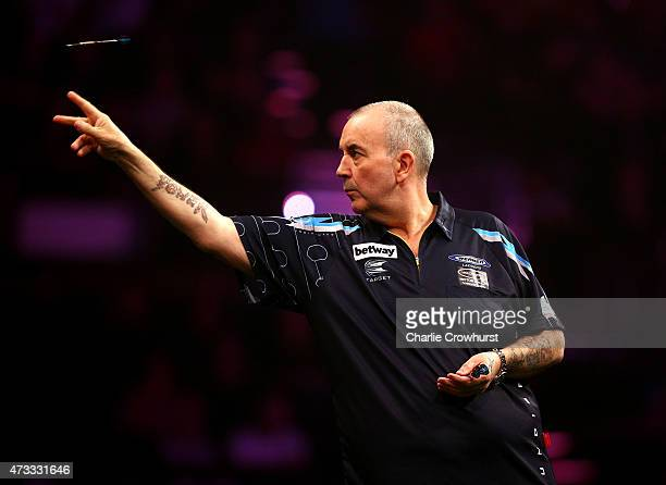 Phil Taylor of England in action during his match against James Wade of England during the Betway Premier League at The Brighton Centre on May 14...