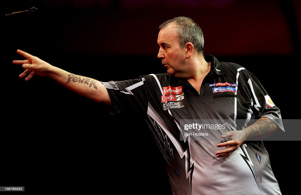Phil Taylor of England in action during his quarter final match against Andy Hamilton of England on day twelve of the 2013 Ladbrokes.com World Darts Championship at the Alexandra Palace on December 28, 2012 in London, England.